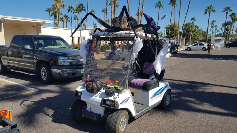 heres the front view of our golf cart with a huge spider on top