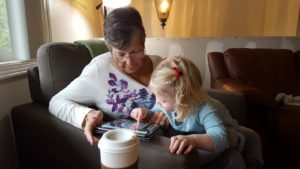 _elaine-cora-with-tablet